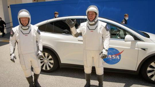 NASA astronauts Douglas Hurley, left, and Robert Behnken, wearing SpaceX spacesuits, are seen as they depart the Neil A. Armstrong Operations and Checkout Building for Launch Complex 39A during a dress rehearsal prior to the Demo-2 mission launch.