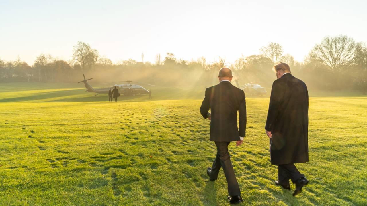 President Donald J. Trump, escorted by U.S. Ambassador to the United Kingdom Woody Johnson, prepares to board Marine One Wednesday, Dec. 4, 2019. (Official White House Photo by Shealah Craighead)
