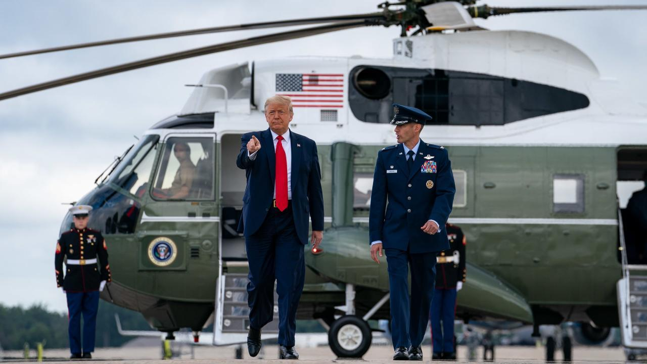 President Donald J. Trump disembarks Marine One at Joint Base Andrews Friday, July 10, 2020, and is escorted to Air Force One by U.S. Air Force personnel. (Official White House Photo by Tia Dufour)