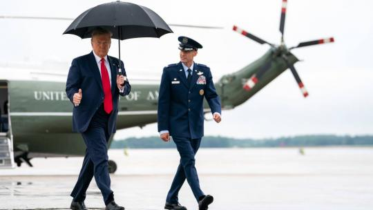 President Donald J. Trump is escorted by Col. Stephen Snelson, Commander of the 89th Airlift Wing, as he walks from Marine One at Joint Base Andrews, Md., Saturday, June 20, 2020, to Air Force One to begin his trip to Tulsa, Okla. (Official WH Photo)