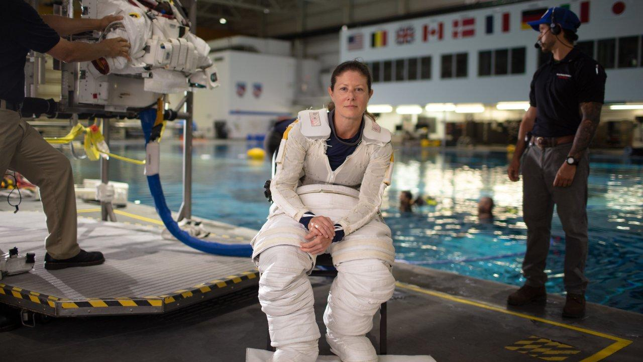 NASA astronaut Tracy Caldwell Dyson pauses for a portrait while donning her spacesuit and going under water in the Neutral Buoyancy Lab, Monday, July 8, 2019 at NASA's Johnson Space Center in Houston, Texas. Photo Credit: (NASA/Bill Ingalls)