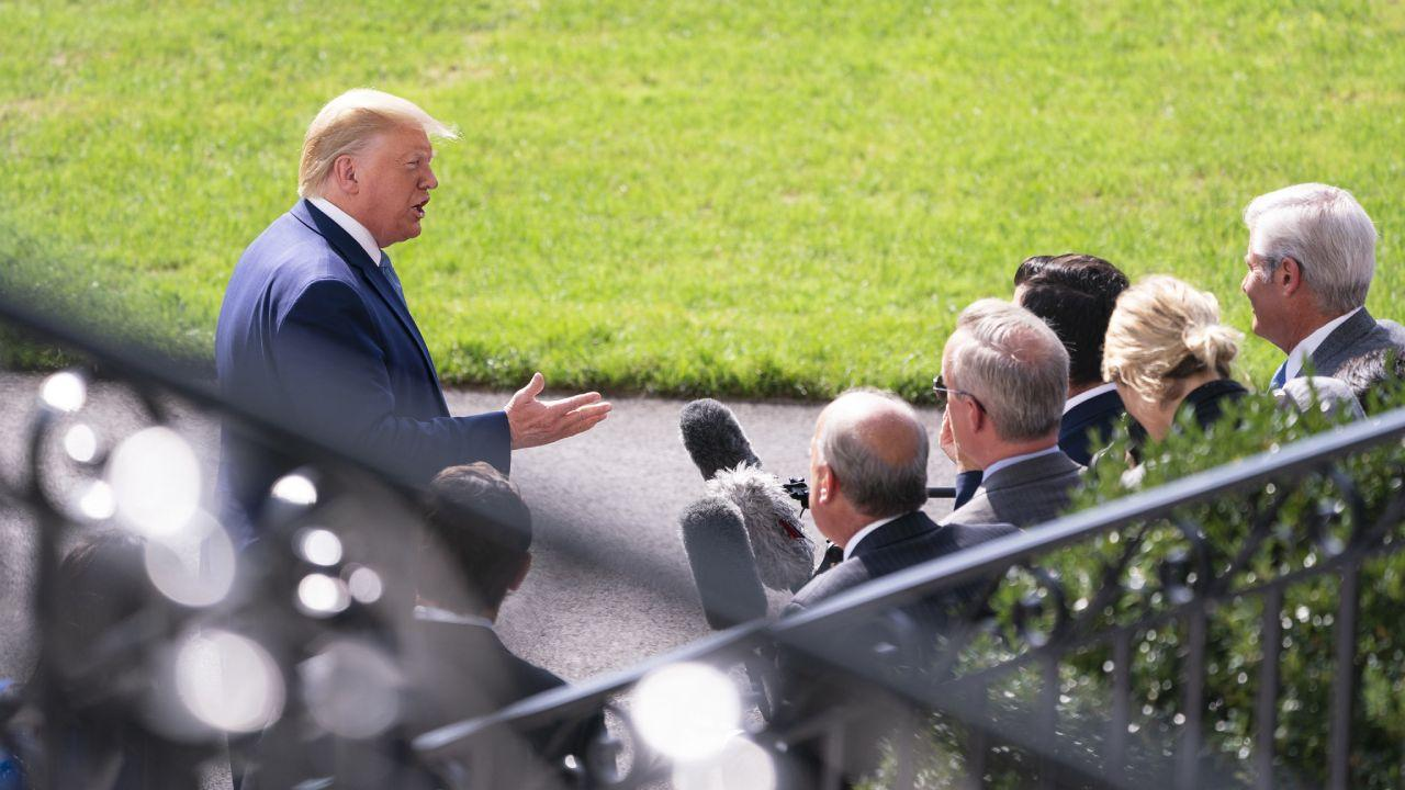President Donald J. Trump talks to members of the press on the South Lawn of the White House Friday, October 4, 2019, prior to boarding Marine One en route the Walter Reed Emergency Landing Zone in Bethesda, Md. (Official White House Photo)