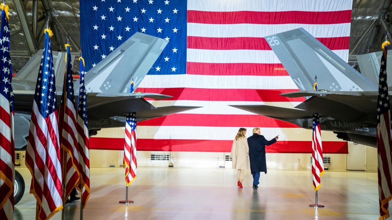 President Donald J. Trump and First Lady Melania Trump depart Hangar 6 at Joint Base Andrews, Md. Friday, Dec. 20, 2019, after signing S. 1790, The National Defense Authorization Act for Fiscal Year 2020. (Official White House Photo by Shealah Craighead)
