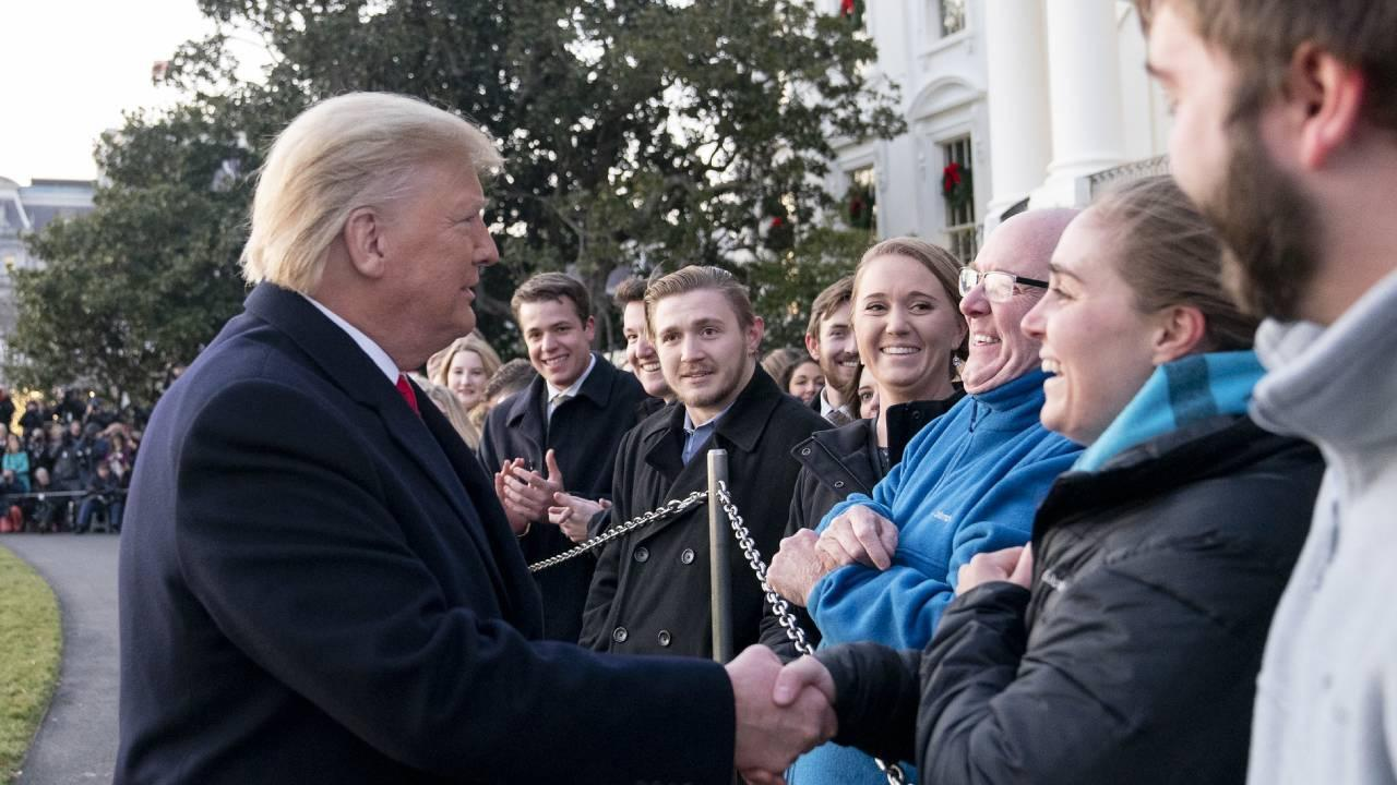 President Donald J. Trump talks to visitors and White House staff members on the South Lawn of the White House Wed. Dec. 18, 2019, prior to boarding Marine One to begin his trip to Michigan. (Official White House Photo by Joyce N. Boghosian)