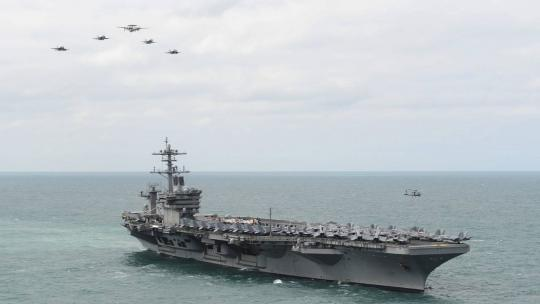 (March 22, 2015) Aircraft from Carrier Air Wing 1 fly in formation over the Nimitz-class aircraft carrier USS Theodore Roosevelt (CVN 71) during an airpower demonstration. (US Navy photo by Mass Communication Specialist 2nd Class Chris Brown/Released)