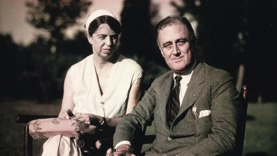Franklin and Eleanor Roosevelt seated on the south lawn at Hyde Park. Photograph by Oscar Jordan. August 1932. (FDR Presidential Library)