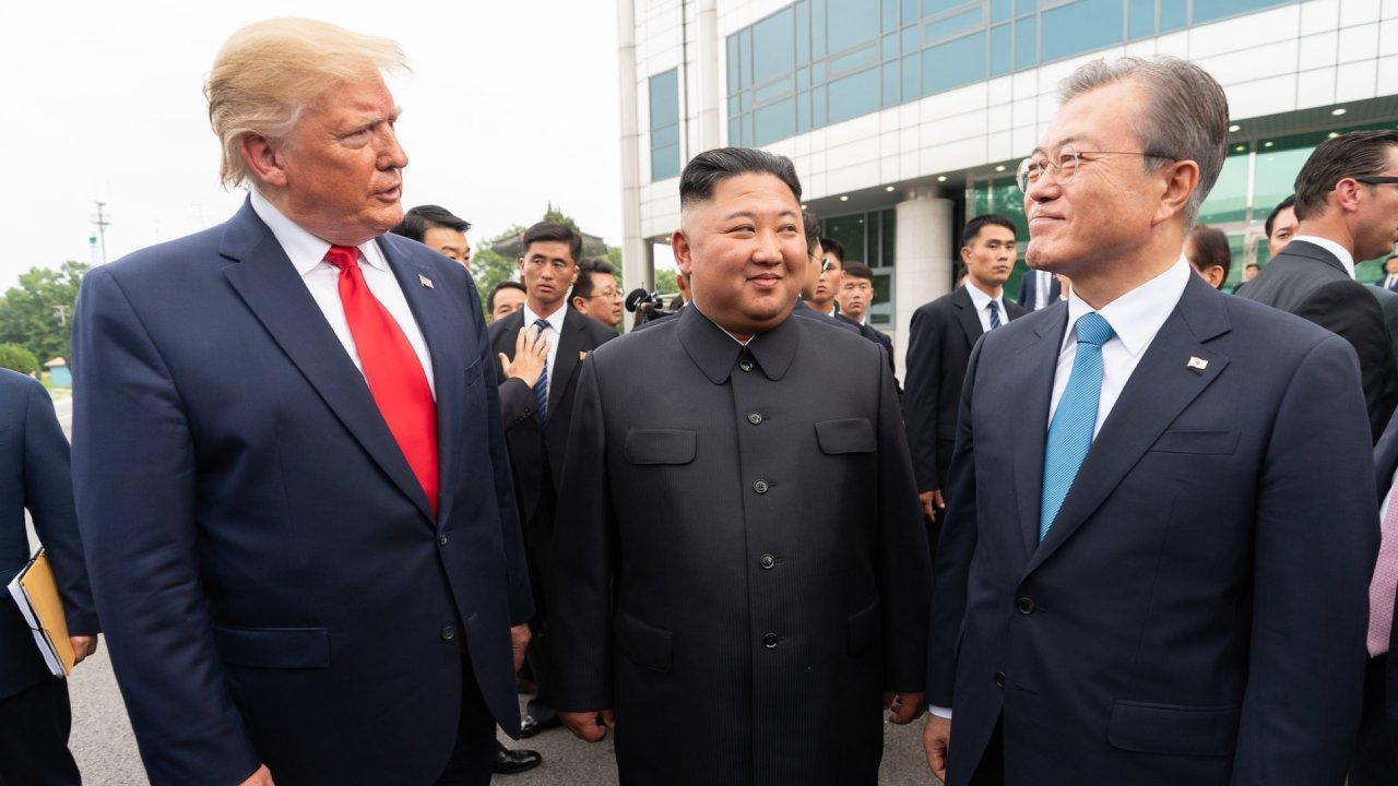 President Donald J. Trump, Chairman of the Workers' Party of Korea Kim Jong Un, and Republic of South Korea President Moon Jae-in talk together Sunday, June 30, 2019, outside Freedom House at the Korean Demilitarized Zone. (Official White House Photo)