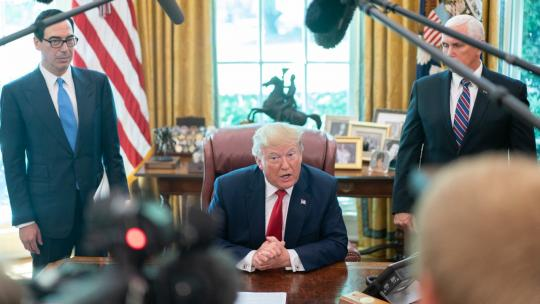 President Trump, joined by Vice President Pence and Treasury Secretary Steven Mnuchin, addresses reporters Monday, June 24, 2019, in the Oval Office of the White House prior to signing an Executive Order to place further sanctions on Iran. (WH Photo)