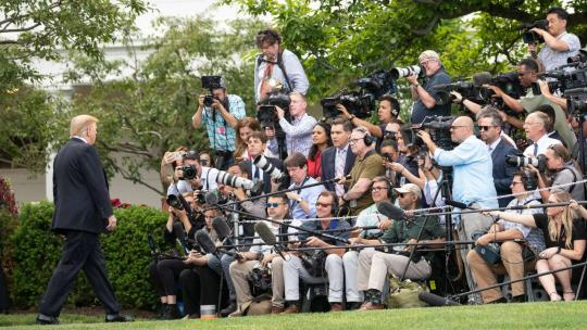 President Donald J. Trump speaks to members of the press on the South Lawn of the White House Monday, May 20, 2019, prior to boarding Marine One to begin his trip to Pennsylvania. (Official White House Photo by Joyce N. Boghosian)