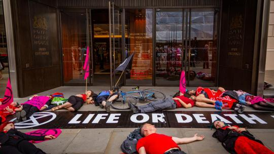 "Seen here, an XR (Extinction Rebellion) ""Die-In"" in front of the Royal Opera House in London England. July 2, 2019. (Photo: Anthony Jarman)"