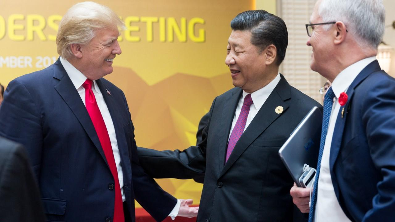 Presidents Donald Trump and Xi Jingping exchange greetings at the APEC Summit | November 11, 2017 (Official Whitehouse Photo)