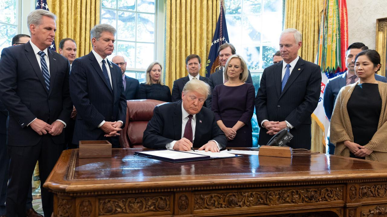 President Donald J. Trump signs the Cybersecurity and Infrastructure Security Agency Act Friday, Nov. 16, 2018, in the Oval Office of the White House. (Official White House Photo by Joyce N. Boghosian)
