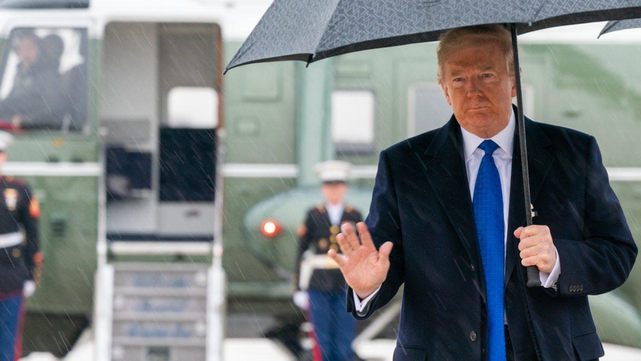 President Donald J. Trump waves after disembarking Marine One at Joint Base Andrews, Md. Monday, December 2, 2019, and walks to board Air Force One for his trip to London. (Official White House Photo by Shealah Craighead)