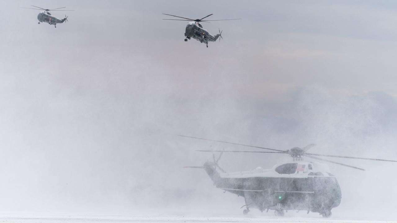 Marine One, center mid-air, carrying President Donald Trump, First Lady Melania Trump, and their son Barron Trump, prepares to land at Joint Base Andrews, MD, February 1, 2019, to board Air Force One for their flight to Palm Beach, Florida.