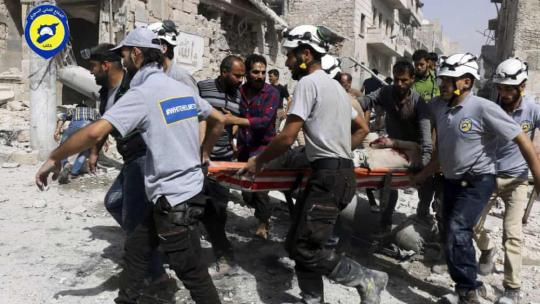 White Helmets rescue workers in the al-Sakhour neighbourhood of eastern Aleppo, Syria, in 2016