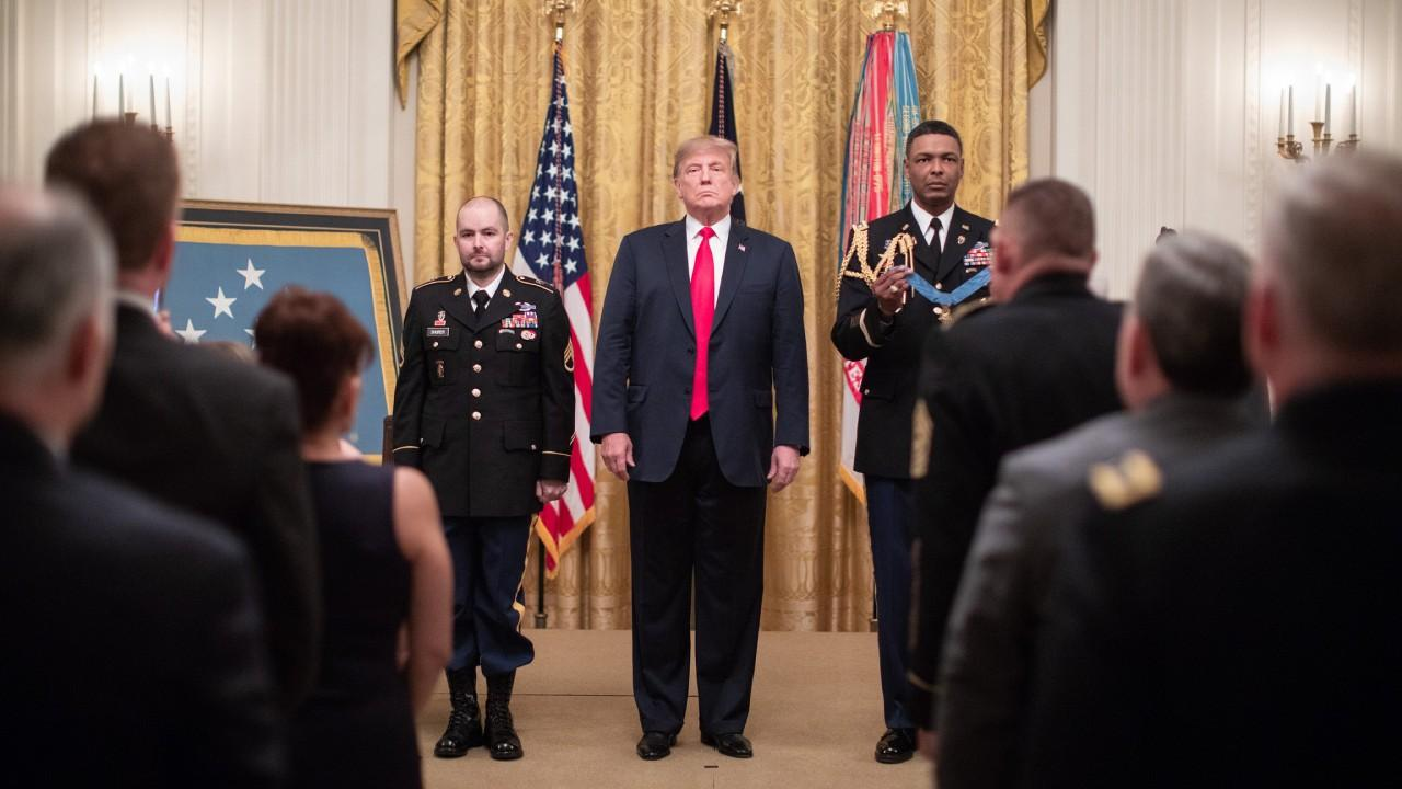 President Donald J. Trump presents the Medal of Honor to retired U.S. Army Staff Sgt. Ronald J. Shurer II Monday, Oct. 1, 2018, in the East Room of the White House. (Official White House Photo by Shealah Craighead)