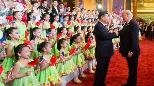 Presidents Donald Trump and Xi Jinping shake hands to applaud and thank the performers at a cultural performance at the Great Hall of the People, Thursday, November 9, 2017, in Beijing, China. (Official White House Photo by Andrea Hanks)