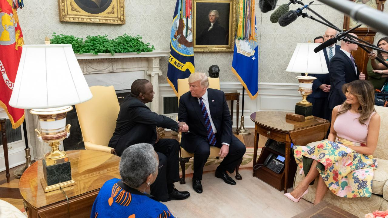 President Donald J. Trump and the President of the Republic of Kenya are joined by First Lady Melania Trump and Mrs. Kenyatta in the Oval Office | August 27, 2018 (Official White House Photo by Andrea Hanks)