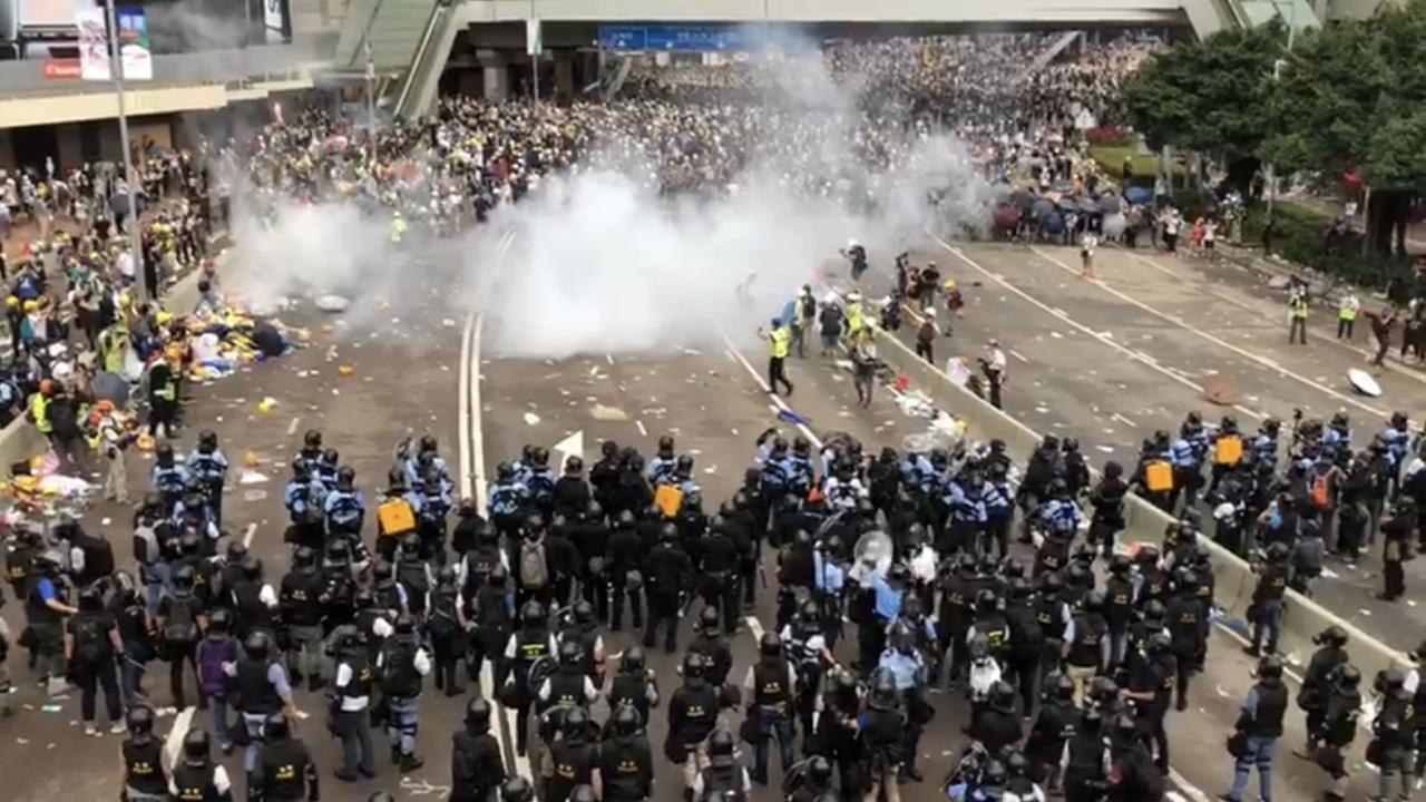 Hong Kong Protesters at Harcourt Road after police fired tear gas at them. 12 June 2019 (Iris Tong / wikimedia)