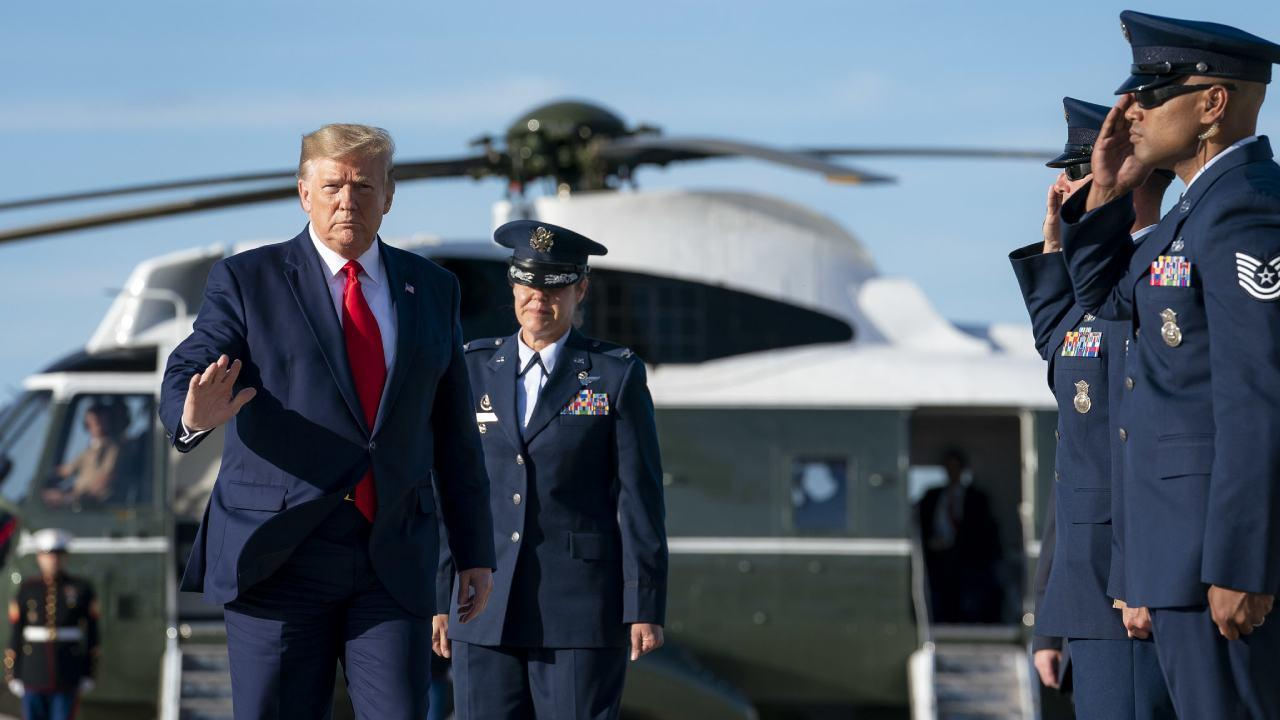 President Donald J. Trump disembarks Marine One at Joint Base Andrews, Md. and is escorted by U.S. Air Force Col. Kimberly Welter Vice Commander of the 89th Airlift Wing Thursday, Oct. 10, 2019. (Official White House Photo by Tia Dufour)
