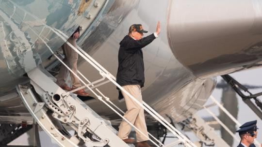 President Donald J. Trump disembarks Air Force One at Beale Air Force Base, Calif., Saturday, Nov. 17, 2018, to begin his visit to Paradise, Calif., which was devastated by wildfires. (Official White House Photo by Shealah Craighead)