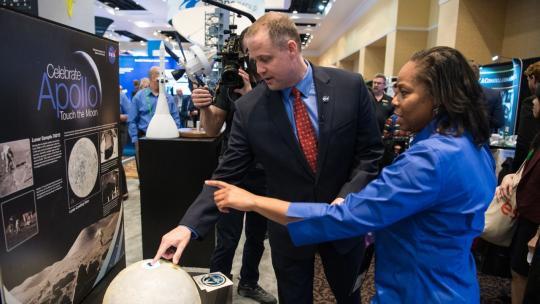 NASA Administrator Jim Bridenstine tours the NASA exhibit at the Space Symposium, Tuesday, April 9, 2019, at Broadmoor Hall in Colorado Springs, Colorado. Photo credit: (NASA/Aubrey Gemignani)