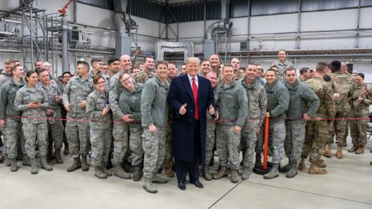 President Donald J. Trump shakes hands and takes photos with military personnel during a stop-over at Ramstein Air Force Base in Germany Wednesday evening, December 26, 2018, following his unannounced visit to U.S. troops at the Al-Asad Airbase in Iraq.