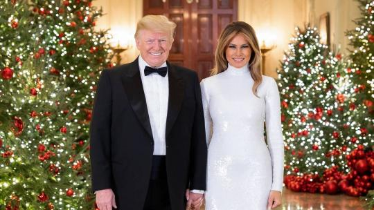 President Donald J. Trump and First Lady Melania Trump are seen in their Official Christmas Portrait on Saturday, December 15, 2018, in the Cross Hall of the White House. (Official White House Photo by Andrea Hanks)