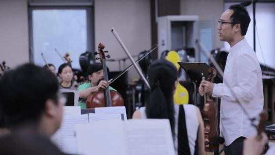 Won Hyung-Joon seen here in a recent documentary about his efforts to form a North / South Korea Orchestra and Chorus. (Screengrab)