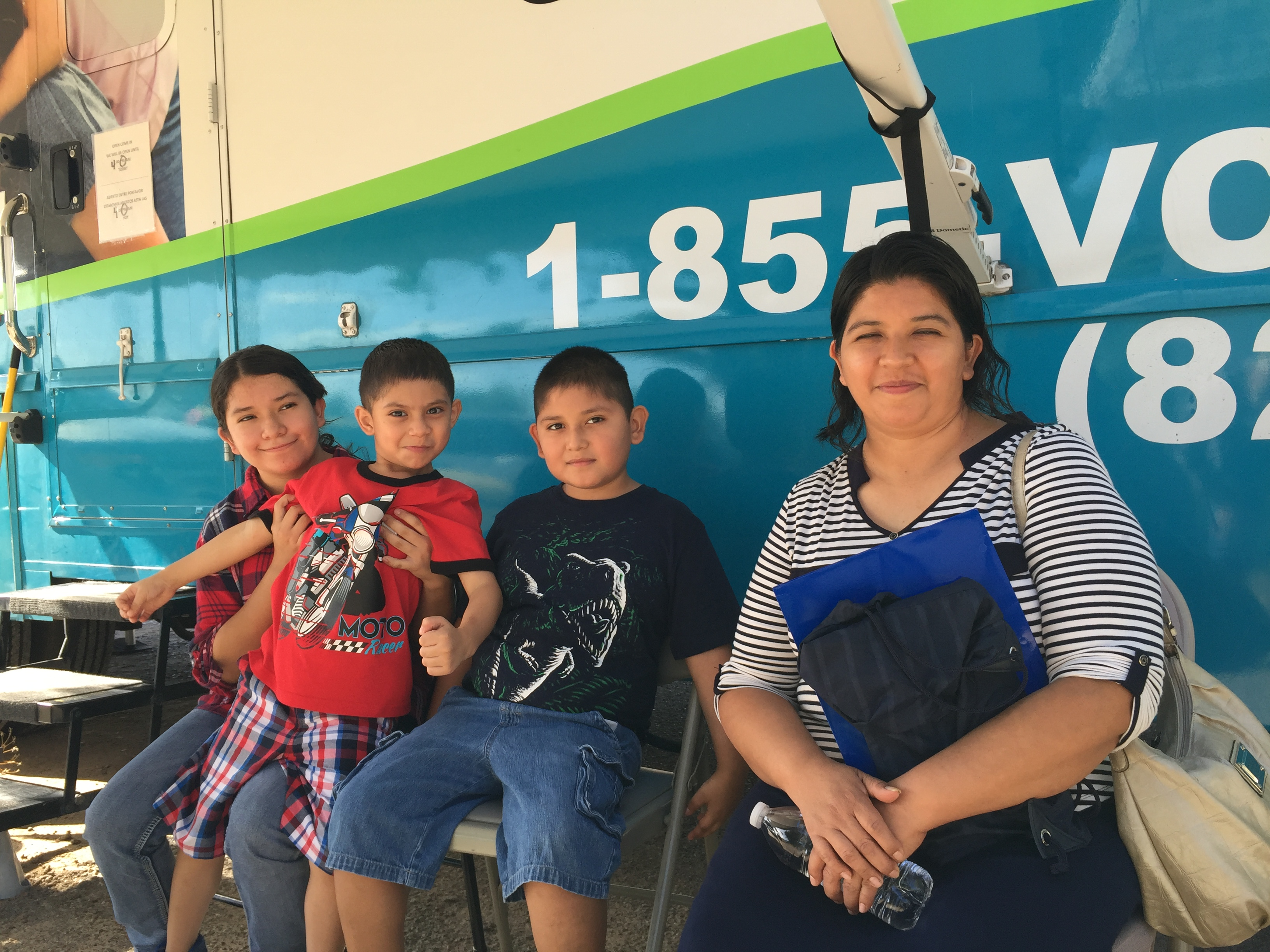 Family receives care at Health On Wheels mobile clinic