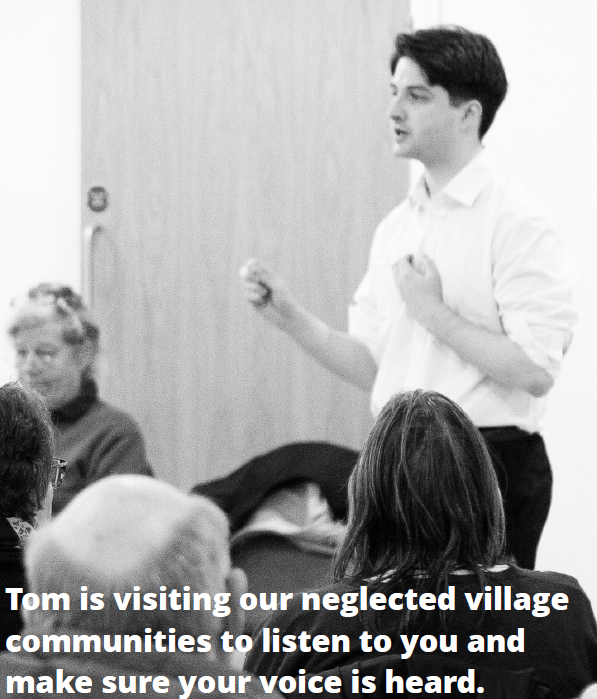 Tom speaking in village