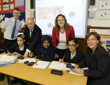 Jenny with headteacher and pupils