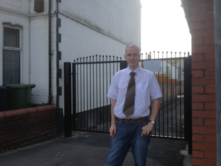 Cllr. Ed Bridges by a gated lane