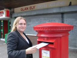 Alison Goldsworthy with a post box