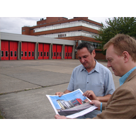 Nigel Howells and John Dixon inspecting the plans outside Adamsdown Fire Station ()