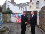 Gareth Holden and Ed Bridges by graffiti
