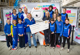 Jenny with Dean Macey, Jacqui Cozens from McDonalds, Wenlock and members of Cardiff AAC