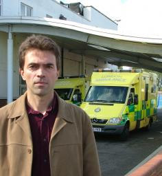 Tom in front of St Helier Ambulance