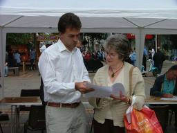 Tom Brake listens to a local resident's concerns about Green Garden Waste