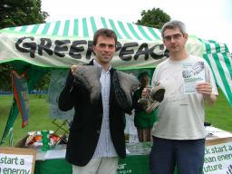 Tom Brake MP (left) seen here giving coal the boot with Greenpeace activist Andrew McParland
