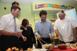 Tom Brake MP (centre right) makes a healthy chicken wrap with Carshalton student Tess Smith (left), Nestle chef Wayne (right) and Paul Burstow MP (far left)