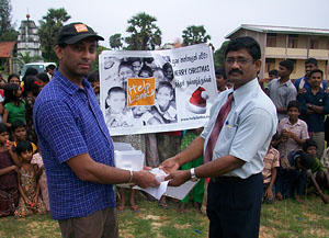 The charity Helplanka is handing over the hearing aids to the Nuffield Deaf School in the city of Jaffna, Sri Lanka