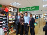 Tom Brake MP and Raj Patel with staff and customers of the Mount Elgon Pharmacy