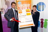 Tom Brake 'cuts' his energy bill at the Big Energy Saving Event Reception in Parliament (John Zammit and Absolute Photography Ltd. )