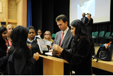 Students get their copies of the book signed by Aneeta Prem and Tom Brake