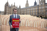 Tom in the symbolic 'field of wheat' set up by ActionAid outside Parliament