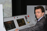 Tom being trained on a train simulator.