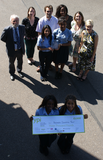 Tom Brake MP with Carshalton High School for Girls staff, PET representatives and the four winning-students - Alriatu, Kimberley (front), Lavanya and Ingrid (back)