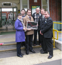 Tom Brake with GLA member Caroline Pidgeon, Councillor John Drage, local commuter Manuel and staff at Carshalton train station.