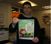 Tom Brake with one of the Get Money Smart campaign posters.